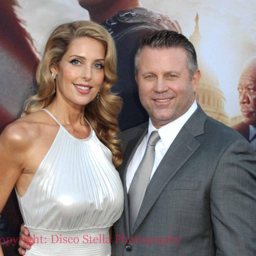 Ric Roman Waugh- Director with wife Tany