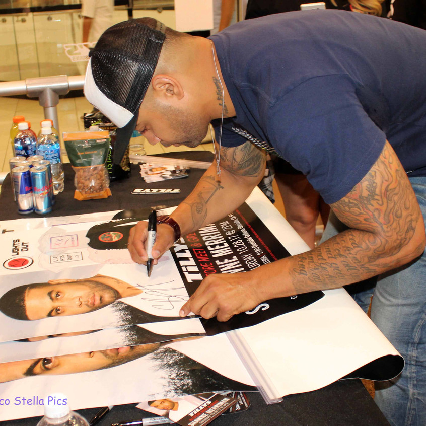 Shawne Merriman signing posters for Tillys