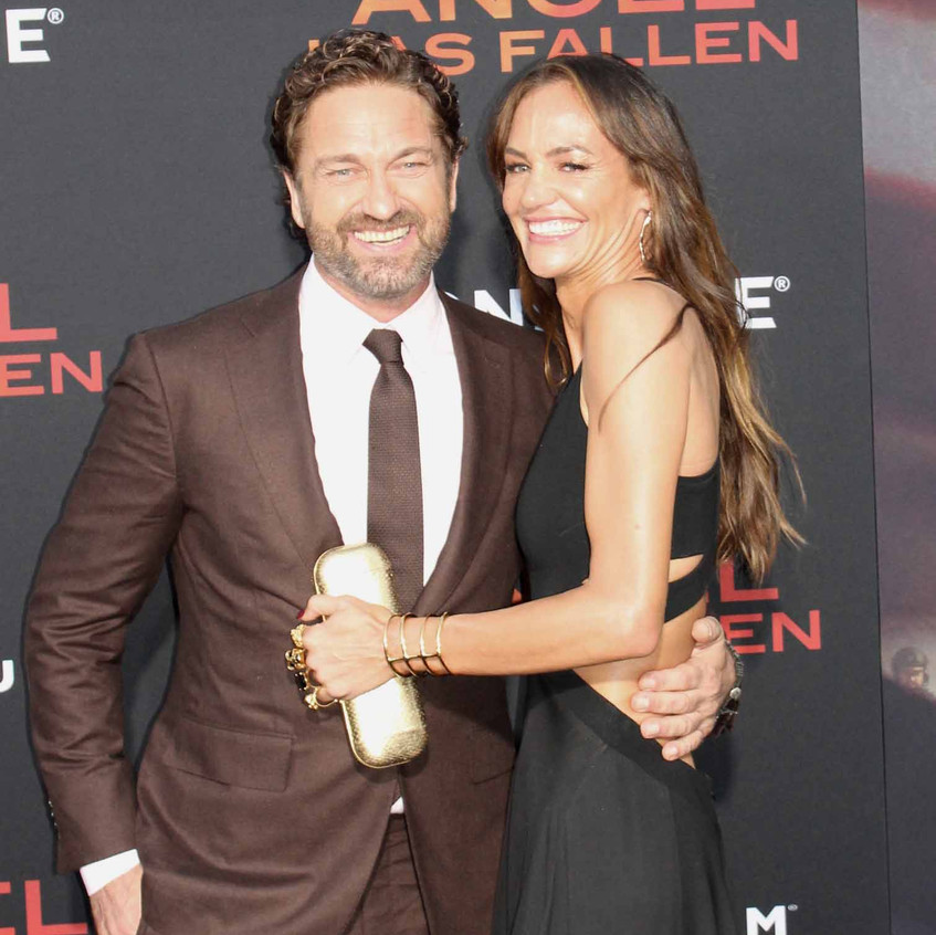 Gerard Butler with lady guest