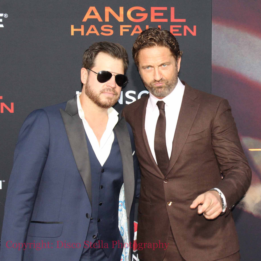 Gerard Butler with guest on the carpet