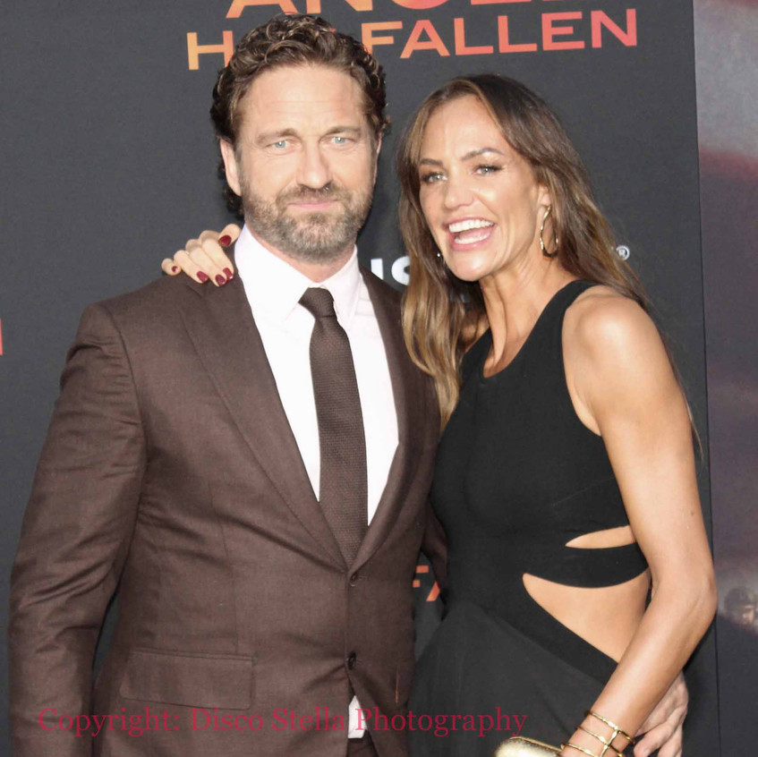 Gerard Butler with guest on the carpet 1