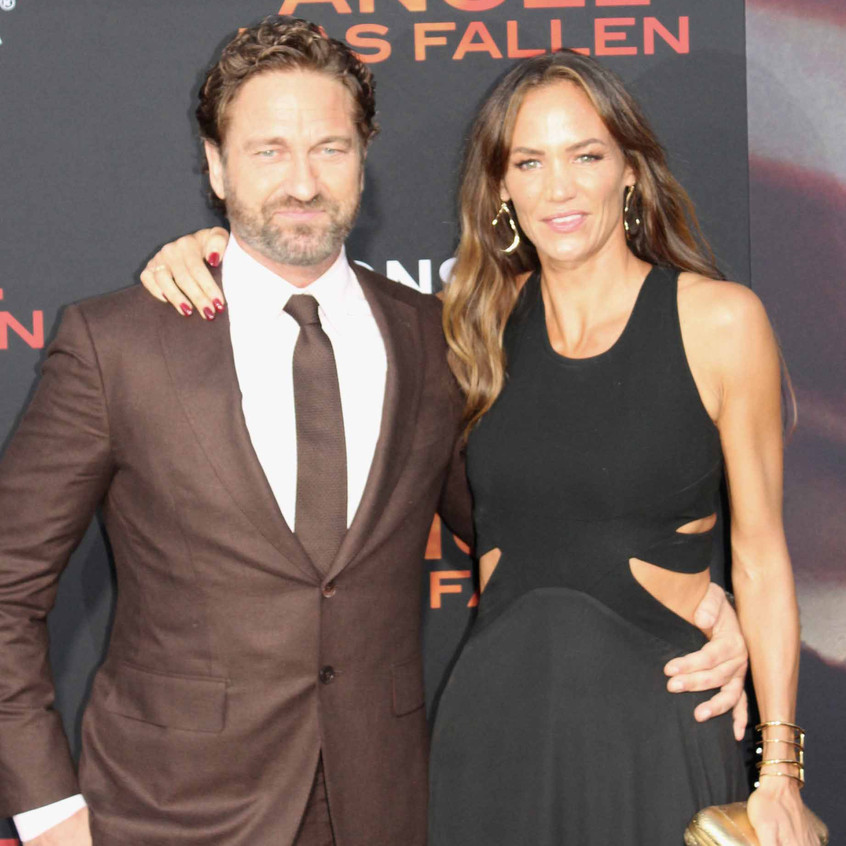 Gerard Butler with lady guest 1