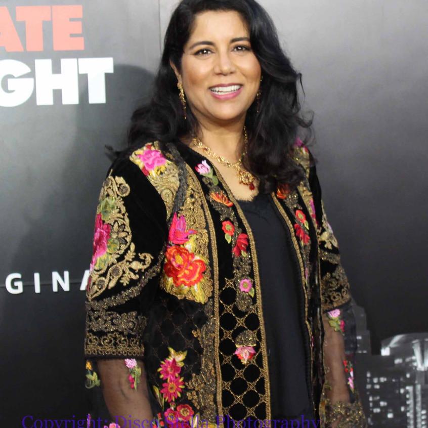 Nisha Ganatra - Director.....