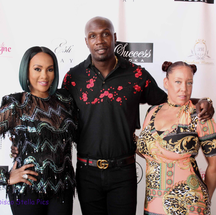 Vivica Fox on the carpet with guests