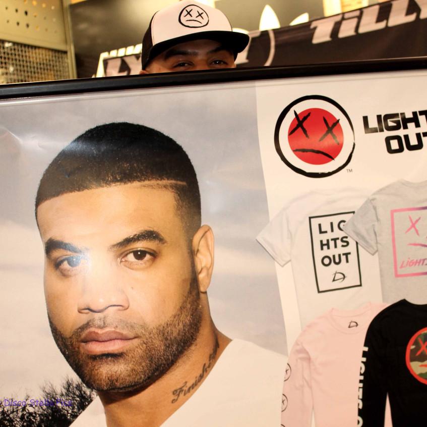 Shawne Merriman hiding behind his poster