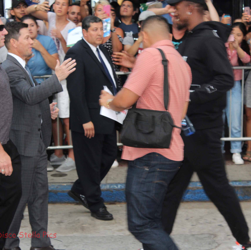 Mark Wahlberg greeting fans and friends.