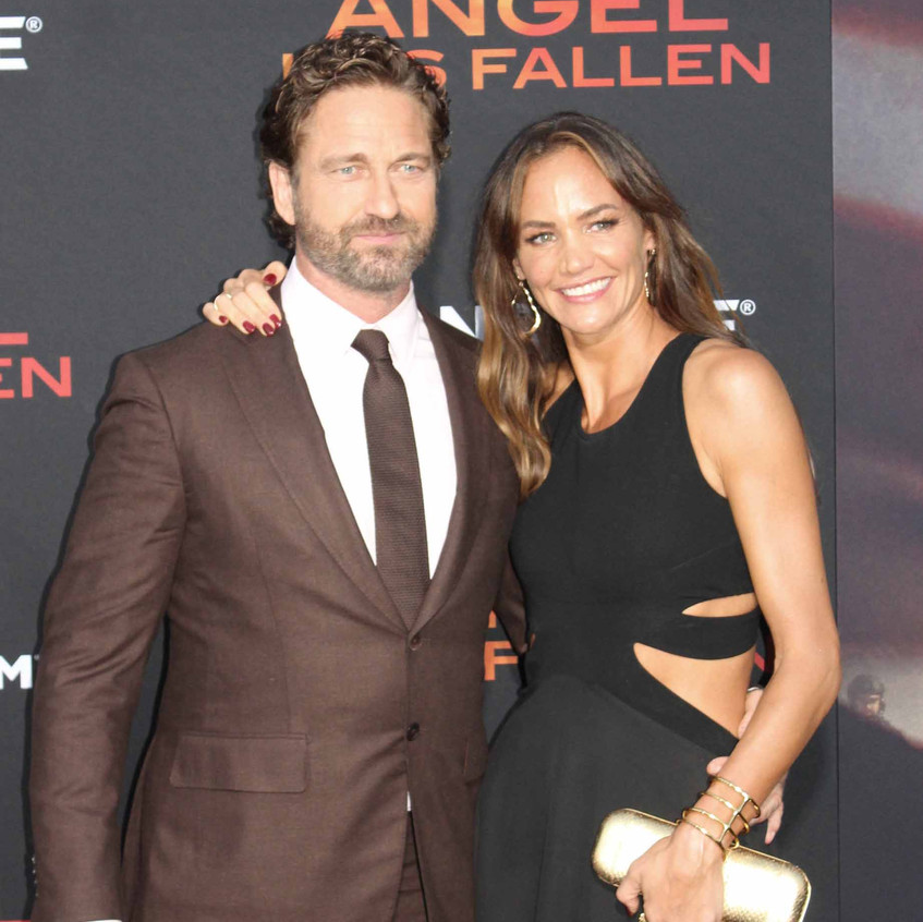 Gerard Butler with lady guest 2