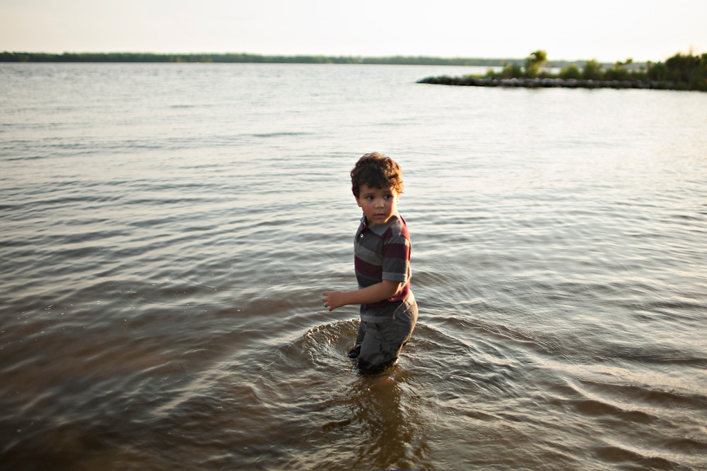boy standing in Patuxent river