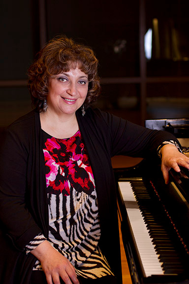 Professor Alla has performed with members of the St. Louis Symphony Orchestra and coached for the Union Avenue Opera Company.