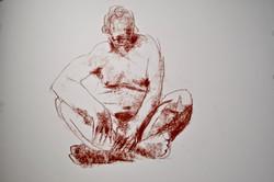 Man, sitting cross legged
