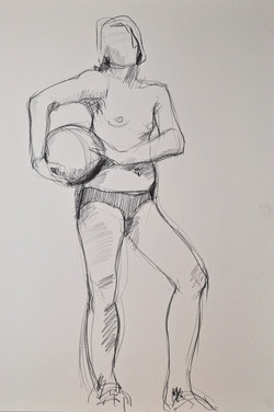 Standing woman holding ball
