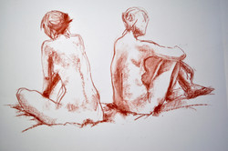 Two women sitting back to back