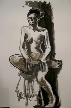 Sitting woman, leg raised