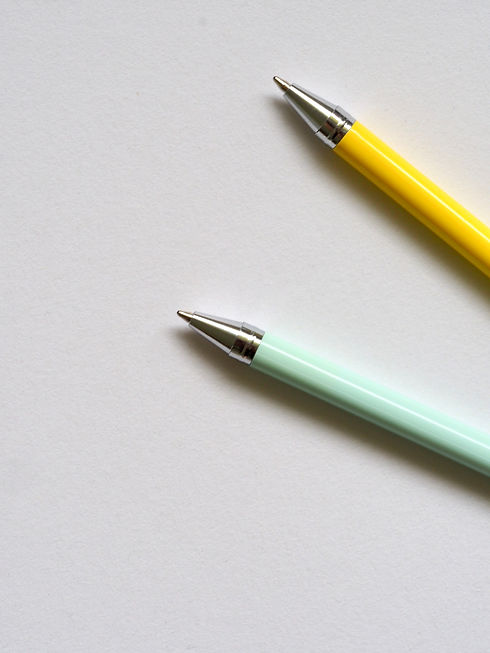 Ballpens illustrating the craft which is writing for a provider of  English to Portuguese language services