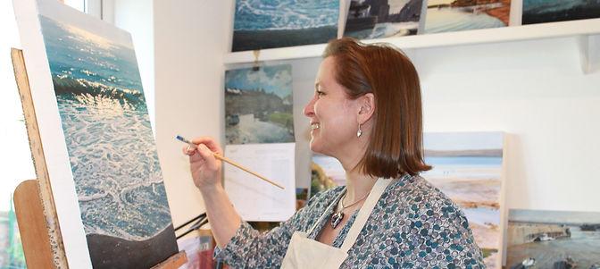 Sarah Poppleton painting in her studio