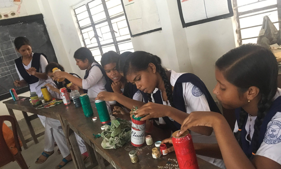 9. Painting old cans to make musical sha