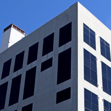 NEMBA - looking up at white building