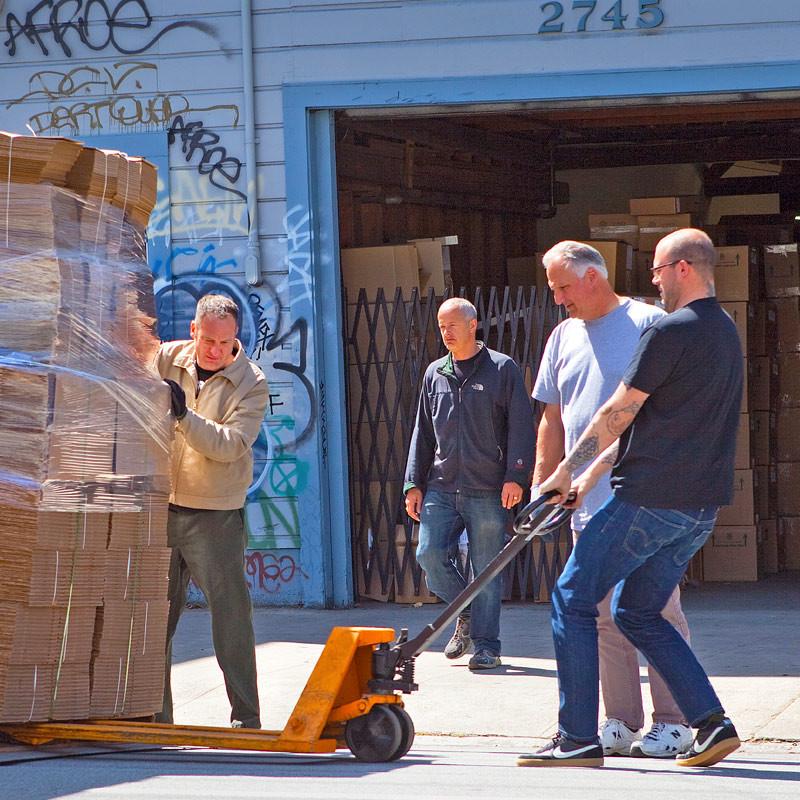 NEMBA - men loading products iin boxes