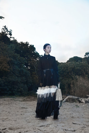 See-through tiered skirt with feather