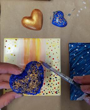 painted tile plaques with hand cast hearts