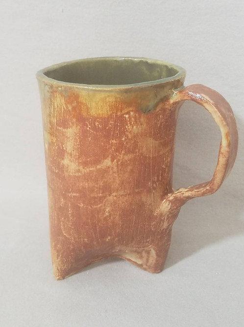 Dripping Green Glaze on a Textured Brown Mug
