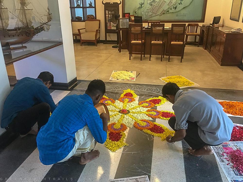 Preparing the flower carpet during Onam