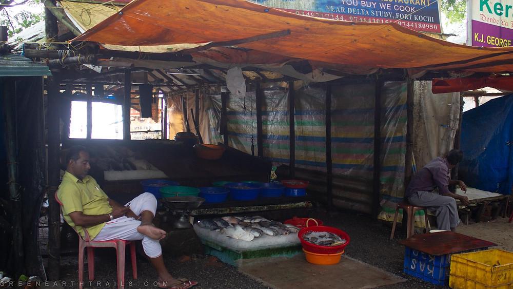 Fishermen selling fish at Fort Kochi