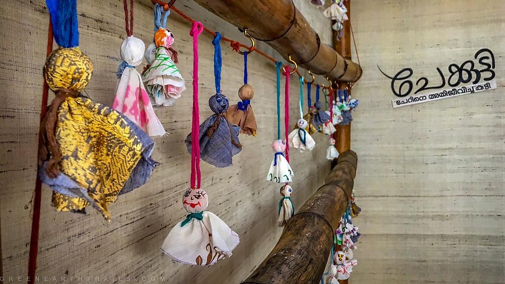 Chekuttys hanging at their Kerala Travel Mart Stall