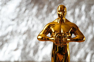 Hollywood Golden Oscar Academy award statue on silver background with copy space. Success