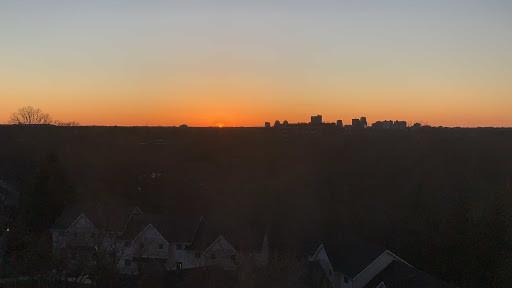 sunset photography of London, Canada with black skyli8ne and orange sky.