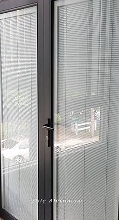 Double casement door with Blind in Glass