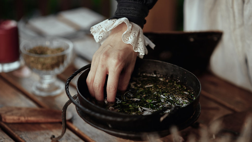 the witch cooks an elixir with herbs in a cauldron_edited.jpg