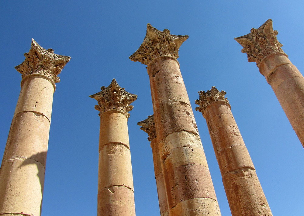 Pillars of an ancient temple rising in the blue sky