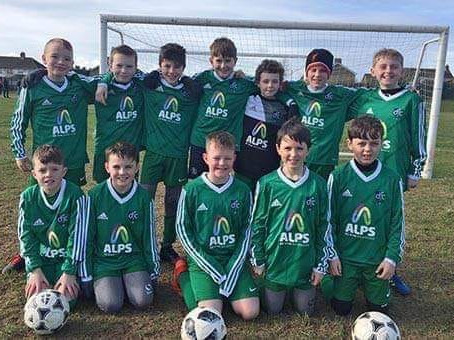 Alps creates Partnership with Downpatrick Football Club