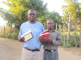 Jean Paulite giving Bibles to pastor.