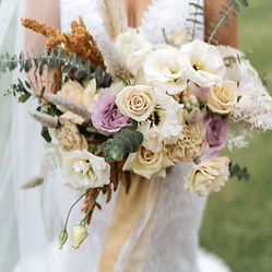 A Wedding bouquet in colours caramel, mauve and cream with a hand dyed silk ribbon