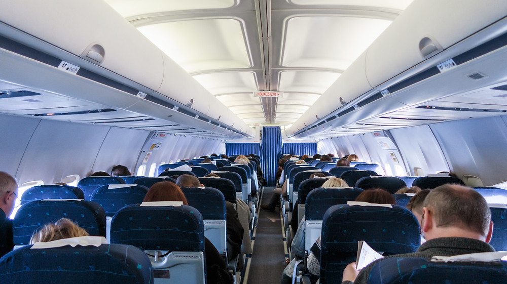 An airplane that, although has empty seats, is not socially distanced