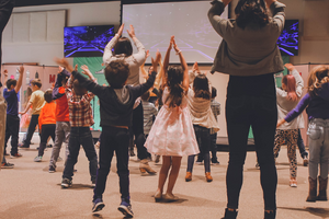 Children dancing and playing together