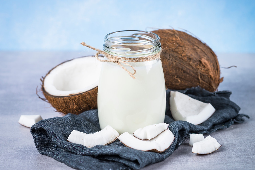 Coconut milk, which typically comes from the meat of a mature coconut.