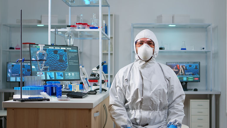 lab-technician-in-ppe-suit-working-with-