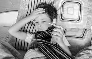 A sick child resting in bed