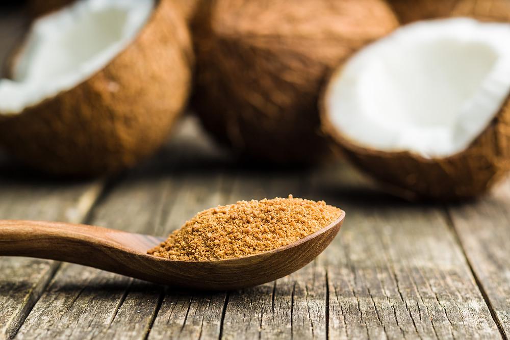 Coconut sugar on a wooden spoon