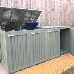 Bin shed with parcel drop