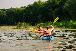 rear-view-two-man-kayaking-lake.jpg