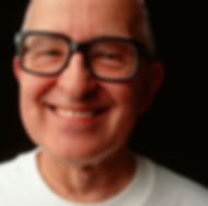 middle aged man with glasses smiling
