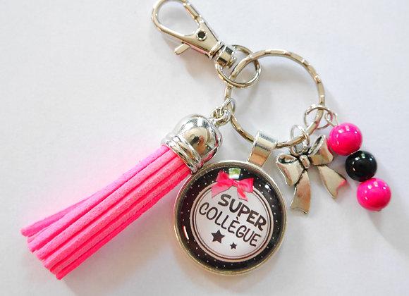 Porte clé rose et noir, une super collègue