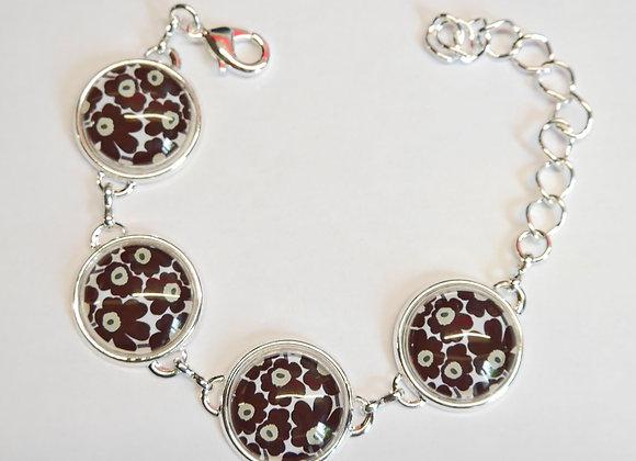 Bracelet cabochon, motifs fleusr noires