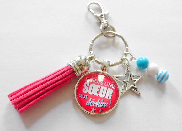 Porte clé rose et bleu, je suis une soeur qui déchire