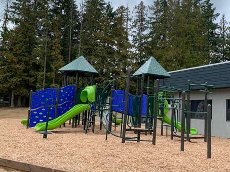 Volunteers install new playground in August