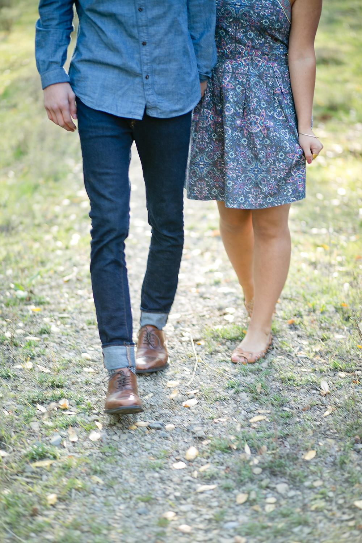 shot of man and women walking